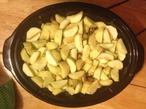Sliced apples in slow cooker.