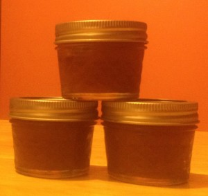 Apple sauce in small 4oz Mason Jars.